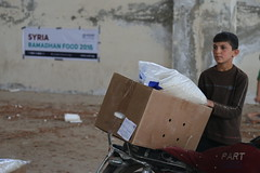 A child in North Hama with Ramadhan supplies for his family (Ummah Welfare Trust) Tags: poverty food children aid hunger syria ramadan humanitarian سوريا سورية humanitarianism