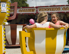 Spinning (Ingleberry2000) Tags: carnival girls red white motion cup yellow hair happy shocked