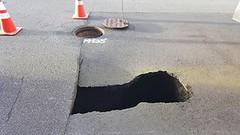 Sinkhole (timkeaty) Tags: sinkhole manhole traffic cones