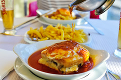 the francesinha wasn't spicy enough, so a 'molho picante' pour-over it is (Gail at Large | Image Legacy) Tags: food portugal maia 2016 francesinha churrascariamirametro