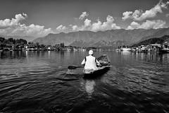 Dal Lake (mehtasunil) Tags: leica blackandwhite lake clouds boat kashmir srinagar leicacamera headinghome dallake leicalens leicaq leicaforum leicaimages leicaindia