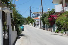(Psinthos.Net) Tags: road flowers trees houses yards light shadow summer sky sunlight leaves car june wall gate day blossoms bluesky bougainvillea cables greenery noon railings treebranches sunnyday       vrisi   psinthos                    vrisiarea peraneighborhood    vrisipsinthos