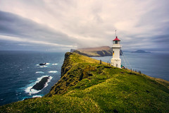 Wayward Wind (West Leigh) Tags: ocean travel sea lighthouse inspiration green nature weather clouds landscape coast peace outdoor north dream peaceful wanderlust explore nordic naturalbeauty faroeislands wander discover travelphotography mykines