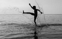 Splish-Splash (kungfuslippers) Tags: blackandwhite beach silhouette contrast liverpool mono sony splash formbybeach sonya7 ilce7 sel55f18z