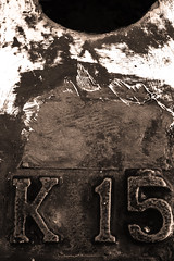 K-15 (Kalibukbuk, Bali) (Triple_B_Photography) Tags: infocus lowcontrast rust rusted pier metal iron scratches scratched weathered worn rough letters number zoom 7d bali blackandwhite seaside sepia canon contrast closeup coastal dark eos filter grain