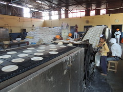 Automatic Chappati Making @ Guru ka Langar .. Golden Temple (BOMBMAN) Tags: india kitchen speed temple golden community mechanical automatic sikh flour tortillas amritsar ka roti guru darbar chappati langar phulka fulka