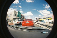 Fish eye (KeepleftDesign) Tags: street travel light blackandwhite bw white fish black building eye art cars love film beautiful car plane 35mm photography design photo student lomography university sydney creative australia automotive olympus om10 retro fisheye lightleaks flare unsw hamiltonisland leaks filmisnotdead filmshooters