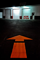 arrow-now-open.jpg (r.nial.bradshaw) Tags: nightphotography color yellow night photography photo creativecommons arrow stockphoto stockphotography nowopen roadpaint royaltyfree attributionlicense dlight incameraedit