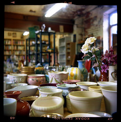 charity emporium bowls (pho-Tony) Tags: italy color colour 120 6x6 analog vintage mediumformat munich square italian kodak tube f45 negative collapse medium format munchen analogue expired astor rollfilm steinheil ektar 75mm c41 ferrania prontor cassar retract kodakektar prontors ferraniaastor