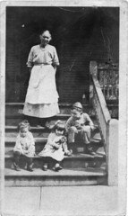 Playing on porch steps (Meyersdale Public Library) Tags: 1920s people children women 1910s porches photobox11