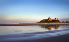 Bamburgh Castle at Sunset (Theresa Elvin) Tags: sunset sea england beach reflections northumberland bamburghcastle