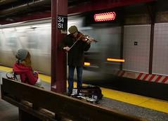 Musical on 34th Street (beanhead4529) Tags: city nyc newyorkcity urban subway metro manhattan streetphotography midtown mta newyorkcitytransit m43 newyorkcitysubway mft midtownsouth metropolitantransportationauthority herladsquare microfourthirds panasonic20mm panasonicgx1 {vision}:{sky}=0514 {vision}:{car}=0522
