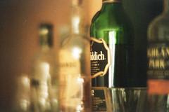 our flat share whisky bar. (dorthrithil) Tags: park film glass field glasses bottle dof bottles asahi pentax k1000 highland jura whisky depth glenfiddich knockandoo