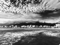 A strip of land between the sky and the sea (elisabartolini) Tags: sea sky blackandwhite italy seascape mountains beach water monochrome clouds landscape outdoors seaside surf waves foam tuscany bnw cloudscape saltwater versilia iphone iphone6