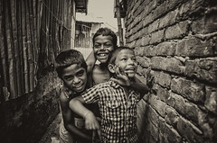 Happiness knows no bounds.. (Rahman Saad) Tags: childhood children blackwhite child outdoor happiness laugh boundary slum groups