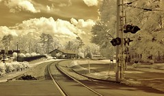 Depot Ahead (Neal3K) Tags: sky sunlight white sepia clouds ir depot infraredcamera rrtracks rrsignal kolarivisionmodifiedcamera
