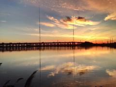 Refreshing Sunrise (Lojones13) Tags: morning sky reflection water clouds sunrise newjersey highway serene refreshing kearny newarkbay