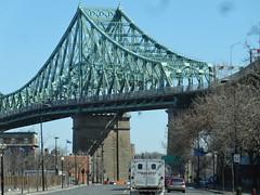 Montreal. Bridge down by the port across the Saint Lawerence River. (denisbin) Tags: bridge church skyline catholic montreal biosphere dome racoon olympicstadium olympicpark oratoirestjoseph parcdumontroyal parcolympique mountroyalpark staqdeolympique