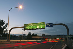 Entering Vancouver (Curtis Gregory Perry) Tags: road city longexposure light green feet lamp sign night vancouver hospital washington nikon highway streetlight ramp 5 five 14 center east 600 convention signage interstate arrow exit copy overhead 1a entering gantry 1b camas demountable d800e