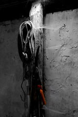 Details lit up in the dark (fabiankoppers) Tags: wood old blackandwhite white black color colour wall strand barn contrast dark concrete darkness details pillar spiderweb rope oldschool holes retro beam lit rough cracks broke rugged scissor darklight shear