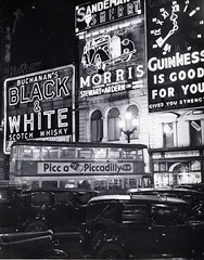 Picka Piccadily Posting (insideonly) Tags: neon signs piccadillycircus blackwhite guinness morris motors