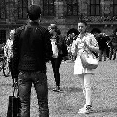 The Lady in white.. (Akbar Simonse) Tags: people urban bw woman man holland blancoynegro girl monochrome beauty amsterdam square zwartwit dam candid nederland streetphotography purse straatfotografie ladyinwhire