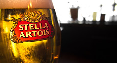 Stella Artois. (CWhatPhotos) Tags: pictures city stella light shadow england house color colour reflection art public water beer glass barley yellow reflections that table four photo pub foto durham with image artistic market drink photos top centre north picture olympus center images east have photograph fotos tavern ingredients yeast which oval tabletop contain lager artois hops 1442mm cwhatphotos epl3