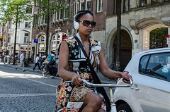head phone (105mm) Tags: city people woman sun girl sunglasses amsterdam fashion bike outfit women candid style streetlife skirt headphone fiets mensen streetstyle