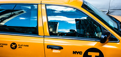 NYC Taxi (angeloangelo) Tags: nyc blue orange ny newyork color detail reflection glass colors car clouds contrast close bright taxi 5d canonef1740mmf4lusm 5dmarkii