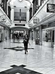 Everyone's In A Rush These Days (Follow That Dream Photography) Tags: bw monochrome mall shopping blackwhite streetphotography shoppingcentre rush shoppingmall shops phonecamera shoppers iphone rushing iphonephotography iphoneography iphone4s snapseedprocessing