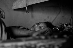 Facing one's own (shankarsarkar) Tags: portrait india face blackwhite women mother relationship kolkata intimacy laying westbengal sonagachi redlightarea trafficked