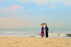"""On the Shore"" - Cochin (Kochi), India (TravelsWithDan) Tags: ocean india beach umbrella couple candid ngc streetphotography romance shore cochin kochi arabiansea worldtrekker"