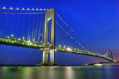Verrazano Blue Hour [EXPLORE] (Moniza*) Tags: new york nyc newyorkcity longexposure bridge cruise blue sunset reflection brooklyn night sunrise landscape island dawn harbor newjersey twilight nikon dusk ships nj explore hour nightlight narrows staten verrazano d90 explored moniza verrazanonarrowsbridge