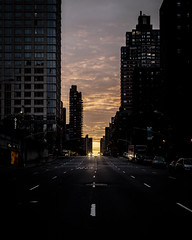 Run Me Down (wwward0) Tags: christmas street nyc sunset clouds contrast vanishingpoint manhattan towers headlights canyon distance amsterdamave