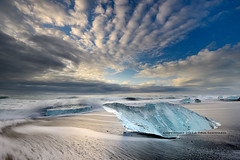 The Ice Museum (pdxsafariguy) Tags: ocean blue winter sea motion black cold ice beach water clouds landscape iceland sand europe waves wave arctic environment iceberg polar jokulsarlon jökulsárlón tomschwabel