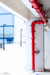 Colourful Red Pipe Art (Wing Yau Au Yeong) Tags: red urban abstract art lines colours bright geometry pipe vivid lampost colourful