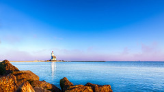 Marken Lighthouse (Bart Ros) Tags: blue reflection water canon stones nh hdr marken foreground