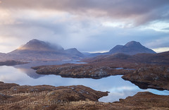 Assynt Sunrise (Phil Walker Photo) Tags: wild sunrise reflections scotland highlands scenic dramatic scottish zen remote loch pinksky barren tranquil ullapool firstlight assynt zenlike
