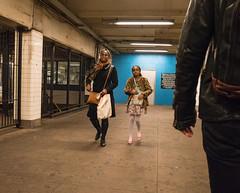 Mother and Daughter (UrbanphotoZ) Tags: nyc newyorkcity ny newyork man leather brooklyn scarf fence booth bag subway construction daughter mother canvas blackjacket boerumhill hoytschermerhorn pinkshoes flowereddress blackcoat leopardcoat floweredbag
