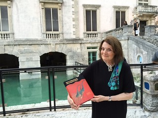 Suzanne Delahanty shows off her book at the Vizcaya presentation by the grotto
