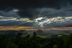 Hole In The Sky (Tim Camin) Tags: wood light summer sky cloud sun sunlight mountain berg skyline clouds forest germany landscape deutschland licht nikon heaven hole cloudy sommer saxony himmel wolken berge sachsen landschaft sonne wald saxon elbsandsteingebirge d7100 cloudhole