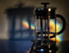 Chasing Rainbows (Anne Worner) Tags: shadow stilllife kitchen glass lensbaby handle rainbow nikon bokeh stovetop plunger goldenhour eveninglight shallowdof coffeepress foundstilllife d7000 plastsic anneworner velvet56