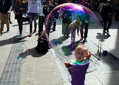 The Child in the Bubble (ken Dowdall) Tags: ireland dublin canon candid bubbles streetscene buskers 5d graftonstreet ef24105