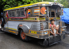 Chilling out in the rain (pommypaul) Tags: kids philippines rainy manila resting jeepney