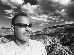 Reminded Again I'm Better Off Alone (Blue Rave) Tags: bw blackandwhite bloke dude guy male mate people hike hiking trail mountains alone moody moodswing ego me self scruff stubble beard iphonephotography iphoneography 2016 selfie serious sunglasses clouds