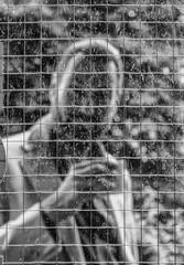 street portrait with obstacles ;-) (Georgie Pauwels) Tags: street blackandwhite window glass candid streetphotography streetportrait dirty fujifilm moment pane glas
