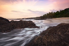 Montezuma Sunrise (Geoffrey Gilson) Tags: pink trees costa clouds sunrise landscapes rocks waves seascapes dynamic rica palm montezuma waterscapes