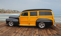 San Clemente Ocean Festival 7.18.15 10 (Marcie Gonzalez) Tags: marcie gonzalez marciegonzalez marciegonzalezphotography photography canon woodies woody pier piers san clemente ocean festival orange county southern california socal so cal beach water oldies oldie car cars vintage antique classic wood paneling panel wooden vehicle transportation classics planks planking chrome metal shinny collector collectors restored elegant elegance parade display show grey day cloudy overcast hot rods event yearly shore coast usa us united states america north americana 2015 sanclementeoceanfestival