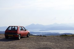 Bealach na Ba (Pass of the Cattle) (MigKenzie Photos) Tags: uk red west skye car coast scotland haze view photos pug style vehicle parked motor peugeot distant 205 bealach migkenzie migkenziephotos l381nss beallaich