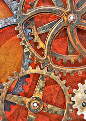 Interconnected (studioferullo) Tags: blue red orange abstract macro art texture beauty lines wheel yellow metal contrast circle design rust colorful pretty pattern bright arc gear line machinery minimalism curve gears